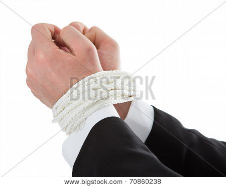 Businessman's Hands Tied With Rope