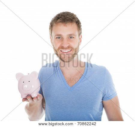 Man Holding Piggybank Over White Background