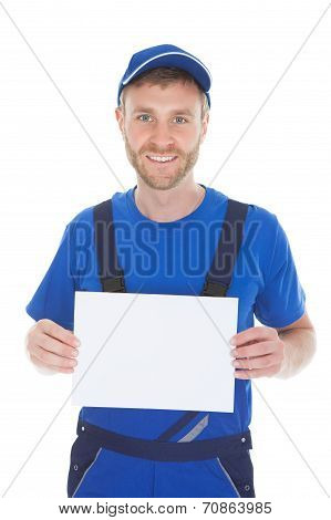 Confident Male Servant Holding Blank Placard