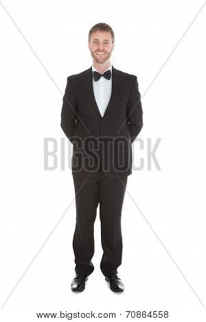 Confident Waiter Standing Hands Behind Back