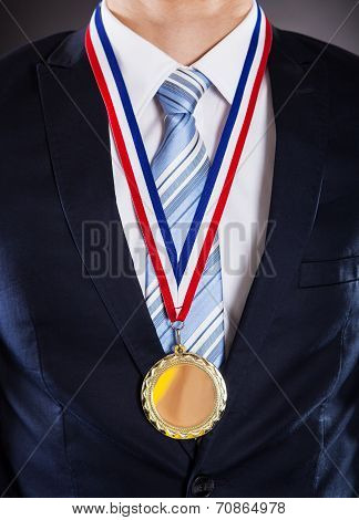 Midsection Of Businessman Wearing Medal