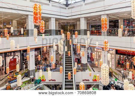 ASHKELON, ISRAEL - JULY 16, 2014: Interior view of Hutzot shopping mall - owned by Aspen Group, offers variety of services like entertainment venues, brand shops, bars, restaurants and movie theater.