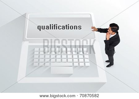 The word qualifications and thoughtful asian businessman pointing against white laptop