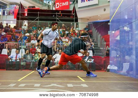 AUGUST 21, 2014 - KUALA LUMPUR, MALAYSIA: Mohamed El Shorbagy (Black shirt) of Egypt plays Mohd Nafilzwan Adnan of Malaysia at the CIMB Malaysian Open Squash Championship 2014 held in Nu Sentral Mall.