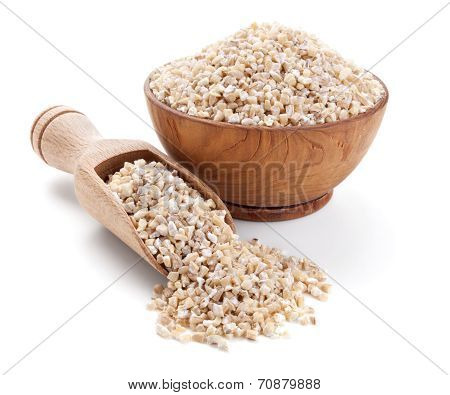 Barley Grits In A Wooden Bowl Isolated On White