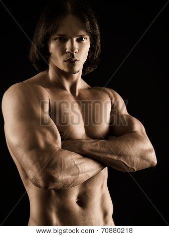 Muscular Young Man With Arms Crossed