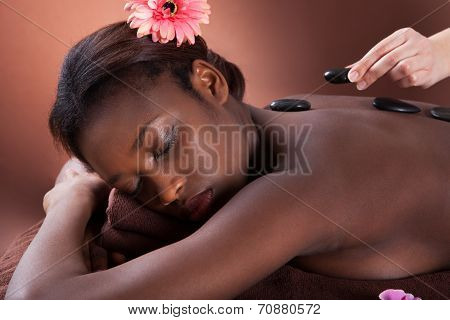 Woman Getting Lastone Therapy At Spa