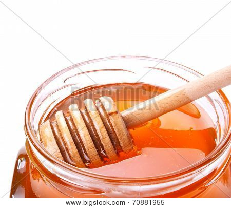 Glass Jar Of Honey With Wooden Drizzler On White