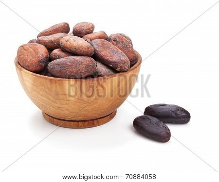 Wooden Bowl Full Of Cacao Beans Isolated On White