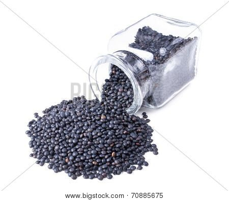 Beluga Lentils Scattered On A White Background
