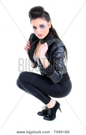 Young beautiful girl in black leather jacket