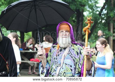 MUSKOGEE, OK - MAY 24: A man dressed in costume enjoys the Oklahoma 19th annual Renaissance Festival on May 24, 2014 at the Castle of Muskogee in Muskogee, OK.