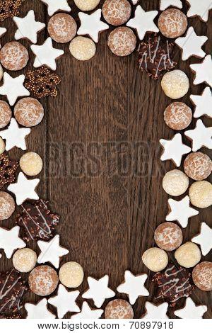 Gingerbread biscuit background border over old oak wood.