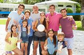 picture of niece  - Multi Generation Family Playing Volleyball In Garden - JPG