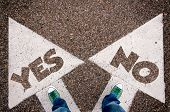 pic of yes  - Yes or no dilemma concept with man legs from above standing on signs - JPG