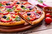 foto of salami  - Pizza with ham peppers and olives with delicious fresh food on a wooden table - JPG