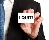 stock photo of quit  - Closeup of businessman showing card with I quit sign - JPG