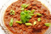 stock photo of scallion  - Hot and Spicy Chili Served with Fresh Scallions - JPG