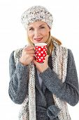 picture of mug shot  - Smiling woman in winter fashion looking at camera with mug on white background - JPG