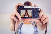 pic of take off clothes  - Pretty brunette taking a selfie with retro camera on couch at home in the living room - JPG