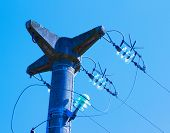 stock photo of utility pole  - Top of electric pole in blue sky - JPG