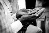 picture of sudan  - closeup of weathered hands of a man praying in South Sudan - JPG
