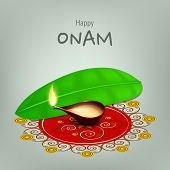 picture of onam festival  - Illuminated oil lit lamp on beautiful rangoli with banana leaf on grey background for South Indian festival Onam celebrations - JPG