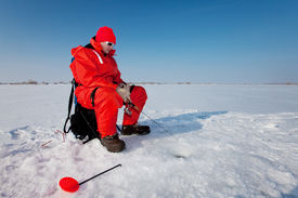 picture of ice fishing  - Fisherman enjoying a days fishing on the ice - JPG
