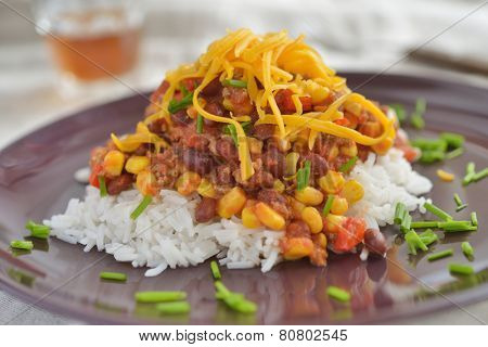 Chili con carne with rice and chives