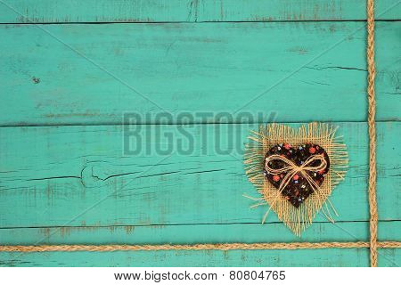 Country fabric heart hanging on distressed wood message board