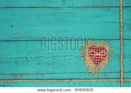 Red country heart on distressed blue wood background