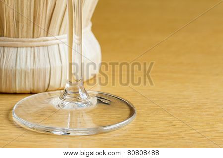 Wine glass with bottle of chianti