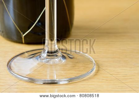 Wine glass with bottle of red wine