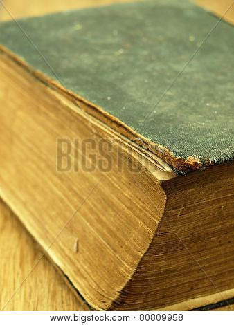 Old Closed The Book With A Damaged Cover.