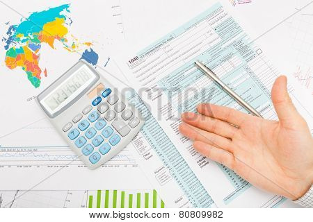 Us 1040 Tax Form, Calculator, Male Hand And Silver Pen