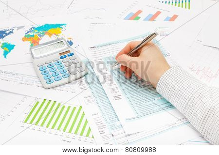 Male Filling Out 1040 Us Tax Form With Ball Pen
