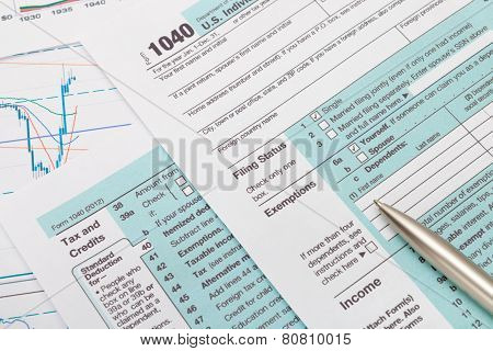 Us 1040 Tax Form And Silver Ball Pen