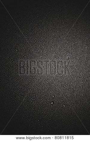 Rain drops on a gray metallic back ground