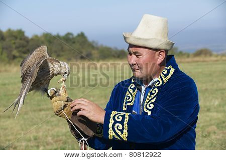 Man feeds falcon, Almaty, Kazakhstan.