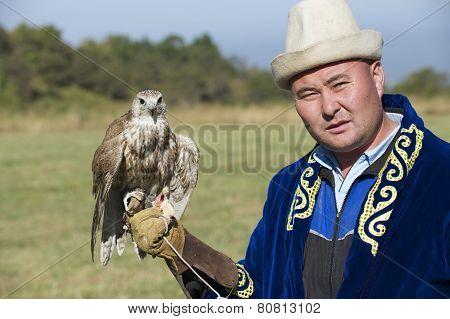 Man holds falcon, Almaty, Kazakhstan.