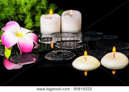 Spa Background Of Plumeria Flower, Green Branch Asparagus And Candles On Zen Basalt Stones With Drop