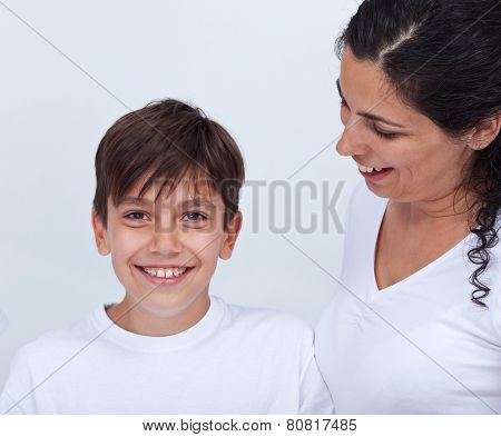 Happy mother and teenage son portrait