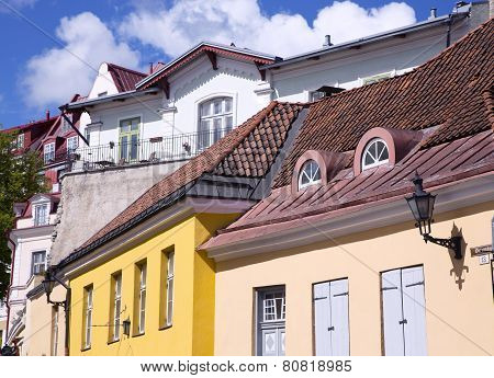 Coloured ancient buildings under the red tiled roof