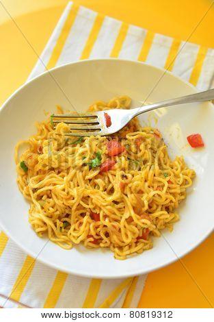 A bowl of instant noodles.