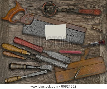 Woodworking Tools And Business Card Over Bench