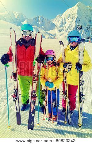 Skiing, winter sport - family enjoying winter vacations, filtered