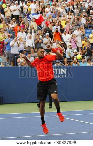 Professional tennis player Jo-Wilfried Tsonga celebrating victory after US Open 2014 round 3 match