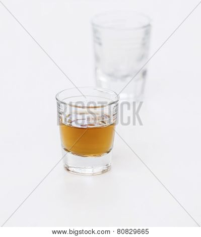 Two Shot Glasses on White