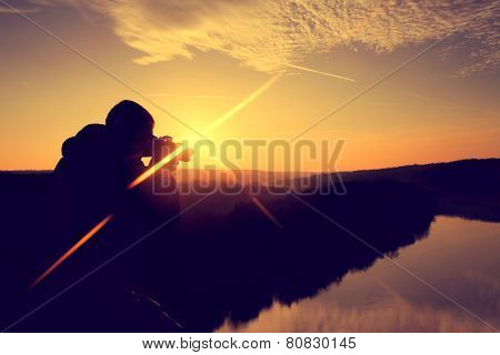 silhouette of the photographer in the morning at sunrise
