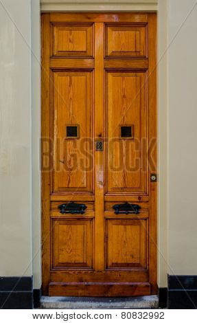 Wooden Door With Thick Black Knockers